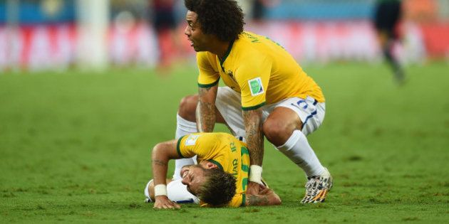 FORTALEZA, BRAZIL - JULY 04: Neymar of Brazil lies on the field after a challenge as teammate Marcelo...