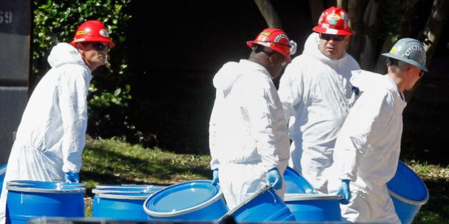 DALLAS, TX - OCTOBER 15: Hazmat workers with Protect Environmental unload barrels in preparation for...