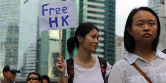 A protester displays a placard during a pro-democracy rally seeking greater democracy in Hong Kong on...