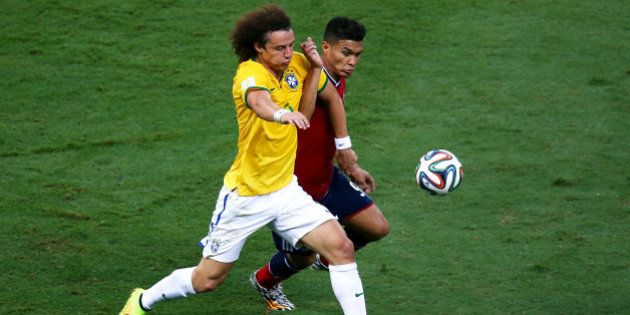 FORTALEZA, BRAZIL - JULY 04: David Luiz of Brazil and Teofilo Gutierrez of Colombia compete for the ball...