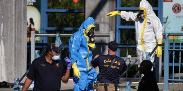 DALLAS, TX - OCTOBER 18: First responders wear full biohazard suits while responding to the report of...