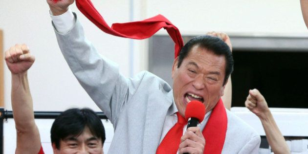 Inoki Antonio, former professional wrestler and a candidate of opposition Japan Restoration Party raises...