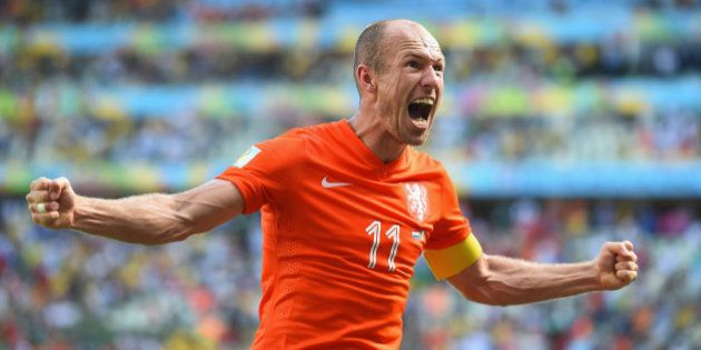 FORTALEZA, BRAZIL - JUNE 29: Arjen Robben of the Netherlands celebrates after defeating Mexico 2-1 during...