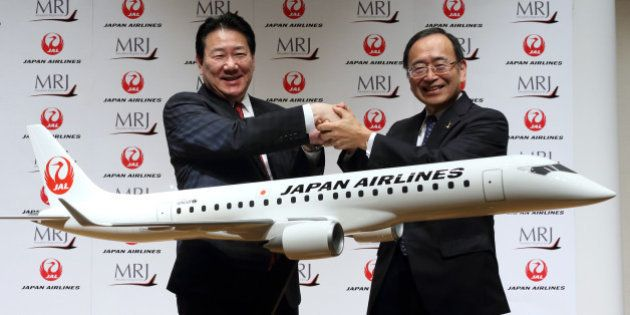 Yoshiharu Ueki, president of Japan Airlines Co. (JAL), left, and Hideo Egawa, chairman and chief executive...