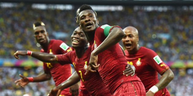 FORTALEZA, BRAZIL - JUNE 21: Asamoah Gyan of Ghana celebrates scoring his team's second goal during the...