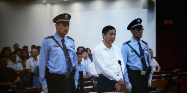 JINAN, CHINA - AUGUST 22: A screen shows the picture of the trial of disgraced Chinese politician Bo...