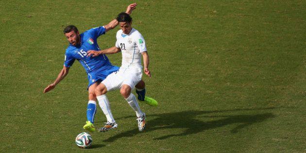 NATAL, BRAZIL - JUNE 24: Andrea Barzagli of Italy and Edinson Cavani of Uruguay compete for the ball...