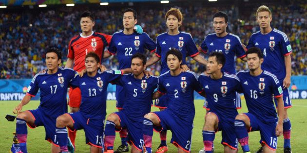 NATAL, BRAZIL - JUNE 19: Japan pose for a team photo during the 2014 FIFA World Cup Brazil Group C match...