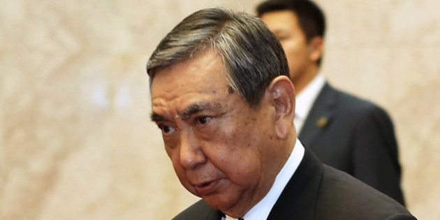 Yohei Kono (C), head of the Japanese Association for the Promotion of International Trade, walks into...