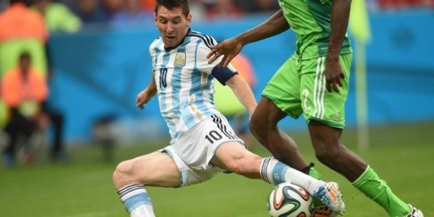 Argentina's forward Lionel Messi (L) vies for the ball with Nigeria's defender Kenneth Omeruo, during...