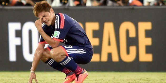 Japan's forward Yoshito Okubo gestures following a 0-0 score during a Group C match between Japan and...