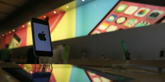 NEW YORK, NY - APRIL 22: An Iphone sits on display at Apple's Fifth Avenue store on Earth Day in Midtown...