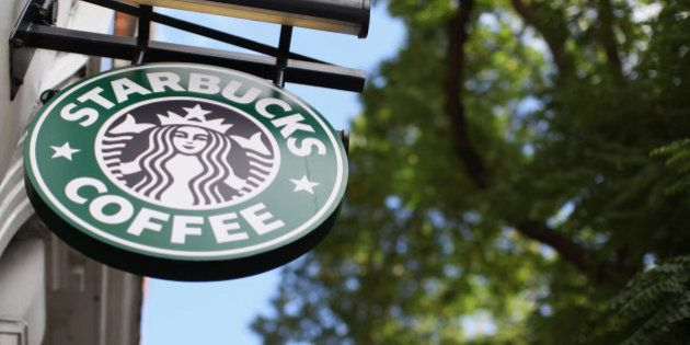 LONDON, ENGLAND - OCTOBER 16: The signage on a branch of Starbucks Coffee on October 16, 2012 in London,...