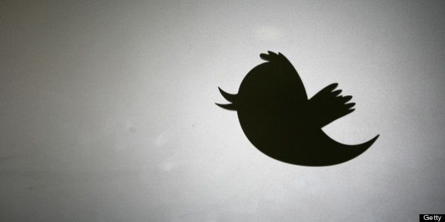 Twitter logo is displayed at the entrance of Twitter headquarters in San Francisco on March 11, 2011...