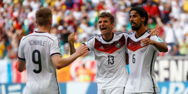 SALVADOR, BRAZIL - JUNE 16: Thomas Mueller of Germany (C) celebrates scoring his team's fourth goal and...