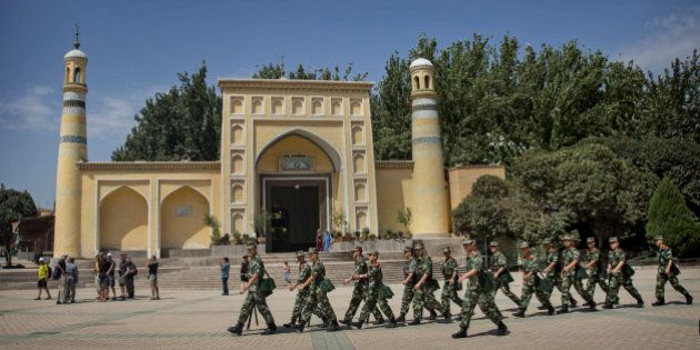 KASHGAR, CHINA - JULY 31: Chinese soldiers march in front of the Id Kah Mosque, China's largest, on July...