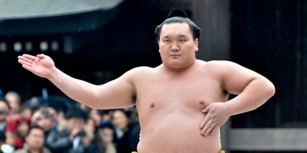 TOKYO, JAPAN - JANUARY 08:  Sumo Grand Champion Hakuho Sho performs 'Dohyo-iri' (ring purification ritual) during Dezuiri ceremony at the Meiji Shrine on January 8, 2014 in Tokyo, Japan. It is a custom for Sumo Grand Champions to celebrate the new year by performing the ritual at the Meiji Jingu Shrine.  (Photo by Keith Tsuji/Getty Images)