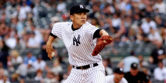 NEW YORK, NY - SEPTEMBER 21: Masahiro Tanaka #19 of the New York Yankees pitches in the first inning...