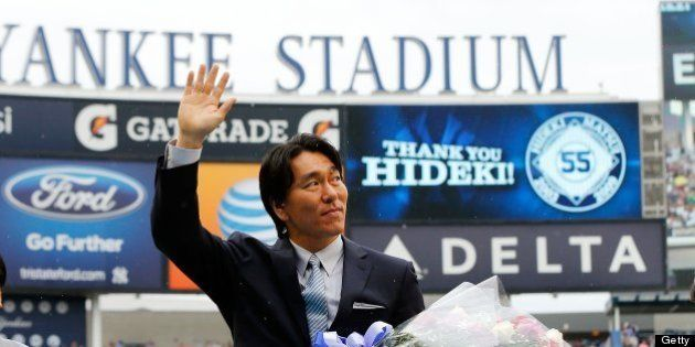 NEW YORK, NY - JULY 28: Former New York Yankee Hideki Matsui waves to the crowd during a pre game ceremony...