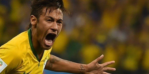 Brazil's forward Neymar celebrates scoring during a Group A football match between Brazil and Croatia...