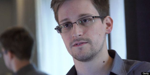 HONG KONG - 2013: In this handout photo provided by The Guardian, Edward Snowden speaks during an interview...