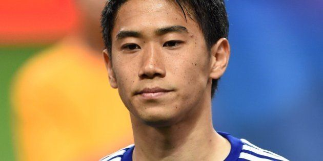 Japan national football team forward Shinji Kagawa poses prior to their internatiional friendly match...