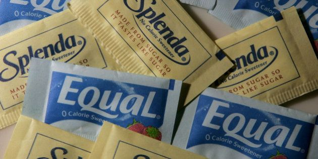 SAN RAFAEL, CA - APRIL 9: Packages of Equal and Splenda artificial sweeteners are displayed at a coffee...