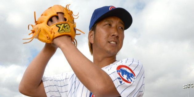 SCOTTSDALE, AZ - FEBRUARY 21: Kyuji Fujikawa #11 of the Chicago Cubs poses during a portrait session...