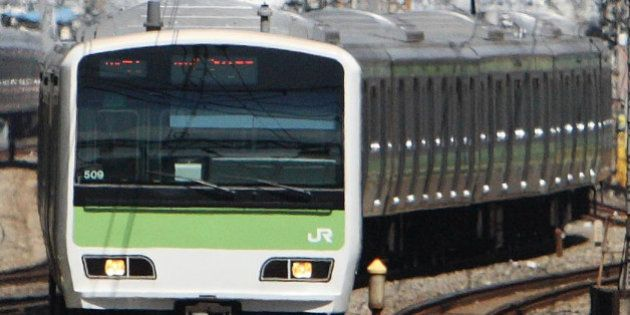 JAPAN - APRIL 01: East Japan Railway Co.'s Yamanote-line train approaches Tokyo Station in Tokyo, Japan,...