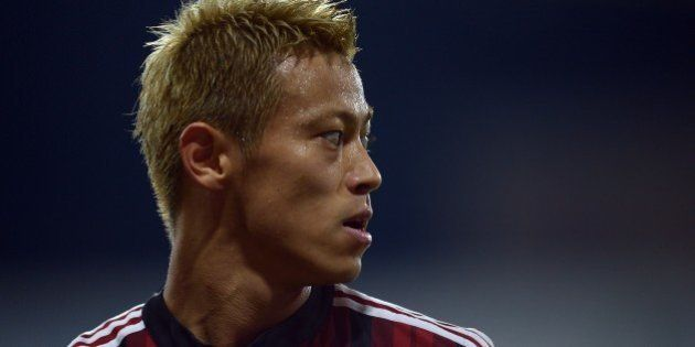 AC Milan's Japanese forward Keisuke Honda reacts during the Serie A football match at Parma's Ennio Tardini...