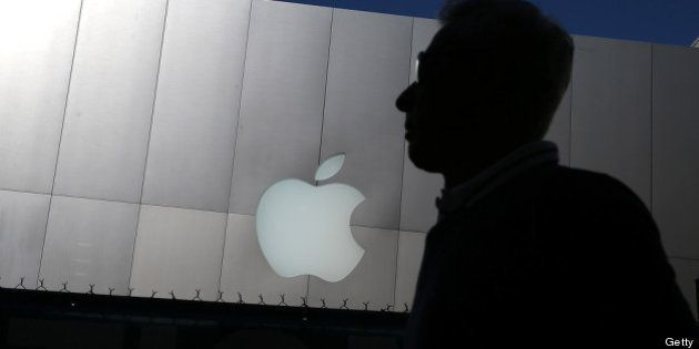 SAN FRANCISCO, CA - APRIL 23: A person walks by an Apple Store on April 23, 2013 in San Francisco, California....