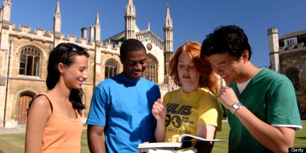Students in the grounds of the Corpus Christi College, founded by Cambridge residents in 1352, Cambridge,...
