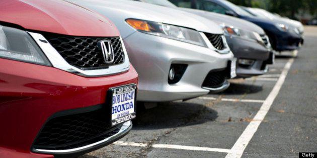 2013 Honda Motor Co. Accord vehicles sit on the lot at Bob Lindsay Honda in Peoria, Illinois, U.S., on...