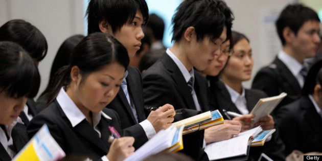 University students attend a job fair hosted by Mynavi Corp. in Tokyo, Japan, on Saturday, Dec. 8, 2012....
