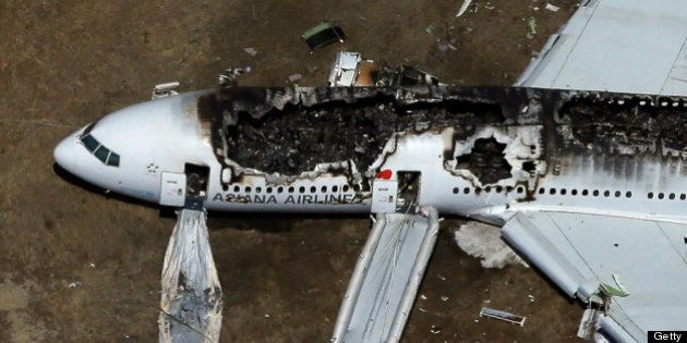 SAN FRANCISCO, CA - JULY 06: A Boeing 777 airplane lies burned on the runway after it crash landed at...