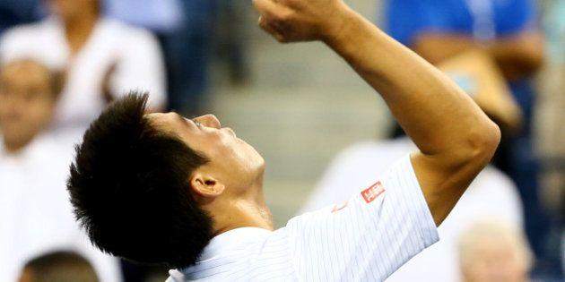 NEW YORK, NY - SEPTEMBER 03: Kei Nishikori of Japan celebrates after defeating Stan Wawrinka of Switzerland...