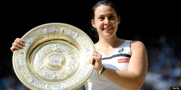 LONDON, ENGLAND - JULY 06: Marion Bartoli of France poses with the Venus Rosewater Dish trophy after...