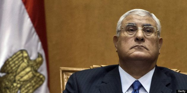 Egypt's chief justice Adly Mansour pauses during his swearing-in ceremony as Egypt's interim president...