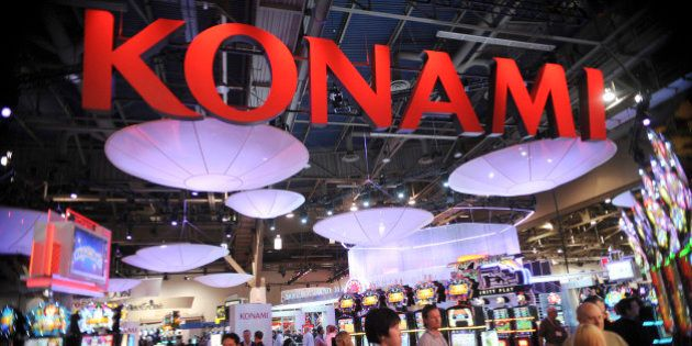 Crowds pass by the Konami booth during the G2E conference held at the Convention Center in Las Vegas,...