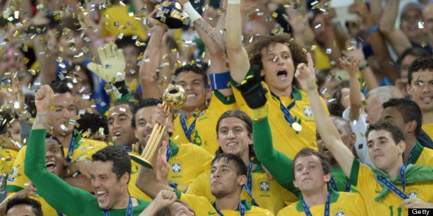 Brazilian players celebrate their victory over Spain 3-0 in the final game of the FIFA Confederations...