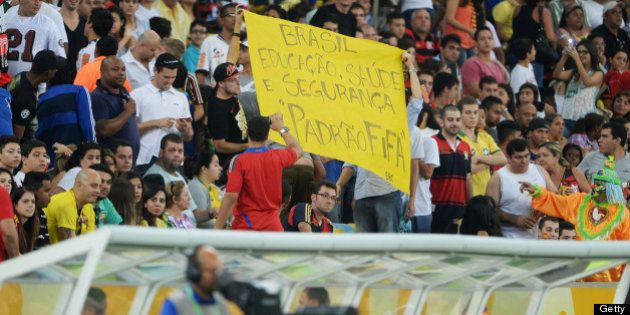RIO DE JANEIRO, BRAZIL - JUNE 20: Protestors display banners during the FIFA Confederations Cup Brazil...