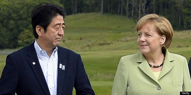 G8 leaders Japan's Prime Minister Shinzo Abe (L) Germany's Chancellor Angela Merkel (C) and Russia's...