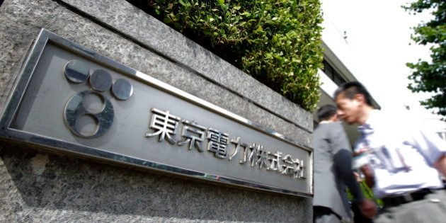 The Tokyo Electric Power Co. (Tepco) logo is displayed outside the company's headquarters in Tokyo, Japan,...