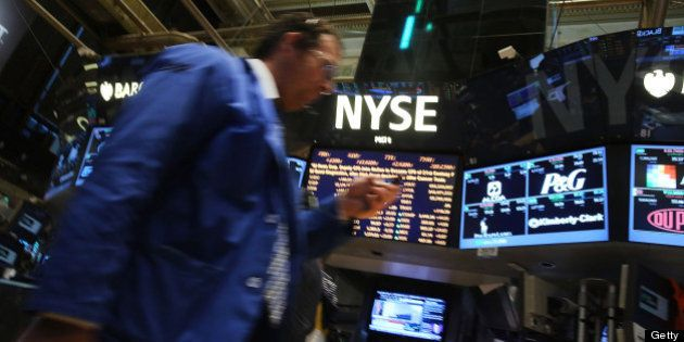 NEW YORK, NY - JUNE 13: Traders work on the floor of the New York Stock Exchange on June 13, 2013 in...