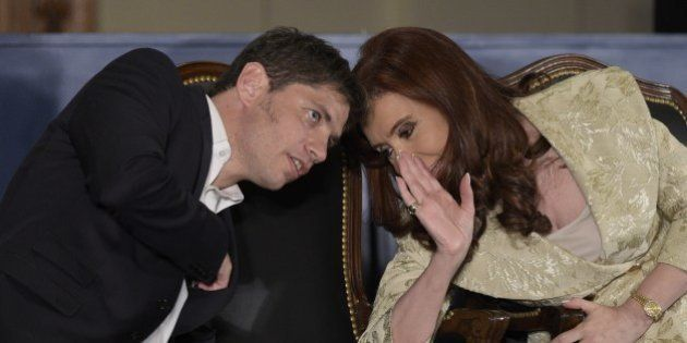 Argentina's President Cristina Fernandez de Kirchner speaks with Argentinian Economy Minister Axel Kicillof...