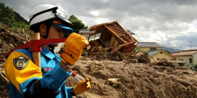 HIROSHIMA, JAPAN - AUGUST 21: Rescue teams continue the search for missing people among the debris of...