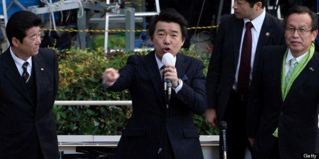 OSAKA, JAPAN - DECEMBER 04: Japan Restoration Party deputy leader Osaka Mayor Toru Hashimoto (C) speaks...