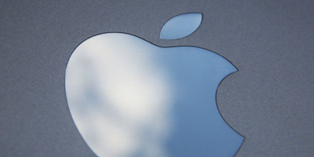 LONDON, ENGLAND - AUGUST 06: In this photo illustration the logo on an Apple iPad is seen on August 6,...