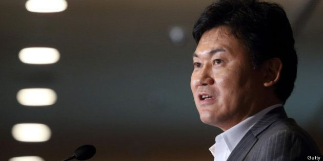 Billionaire Hiroshi Mikitani, chairman and chief executive officer of Rakuten Inc., speaks at the Foreign...