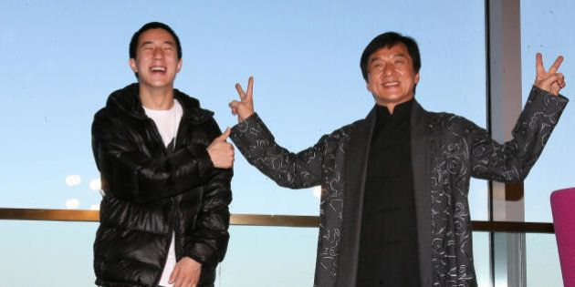 Hong Kong entertainer Jackie Chan (R) poses with his son Jaycee Fong Jo Ming as they take part in a press...